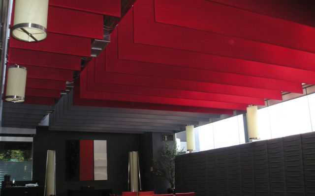 red acoustic baffles in restaurant ceiling