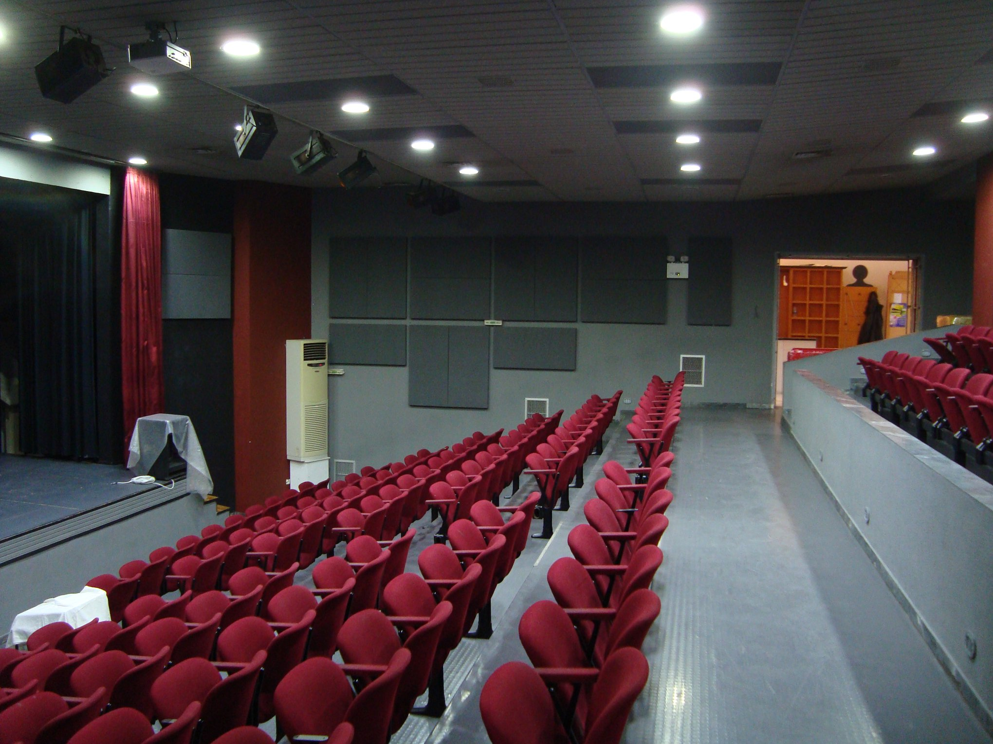Acoustic treatment for auditorium with fabric acoustic panels