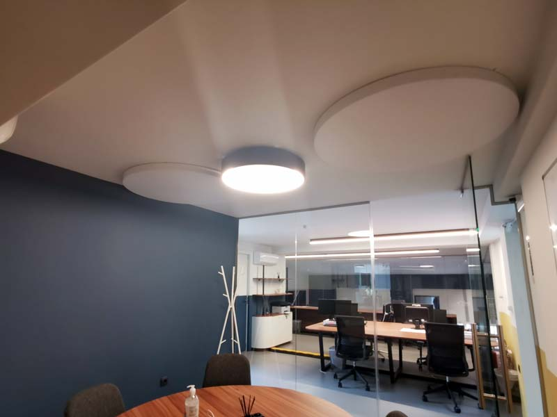 circle acoustic panels on the ceiling