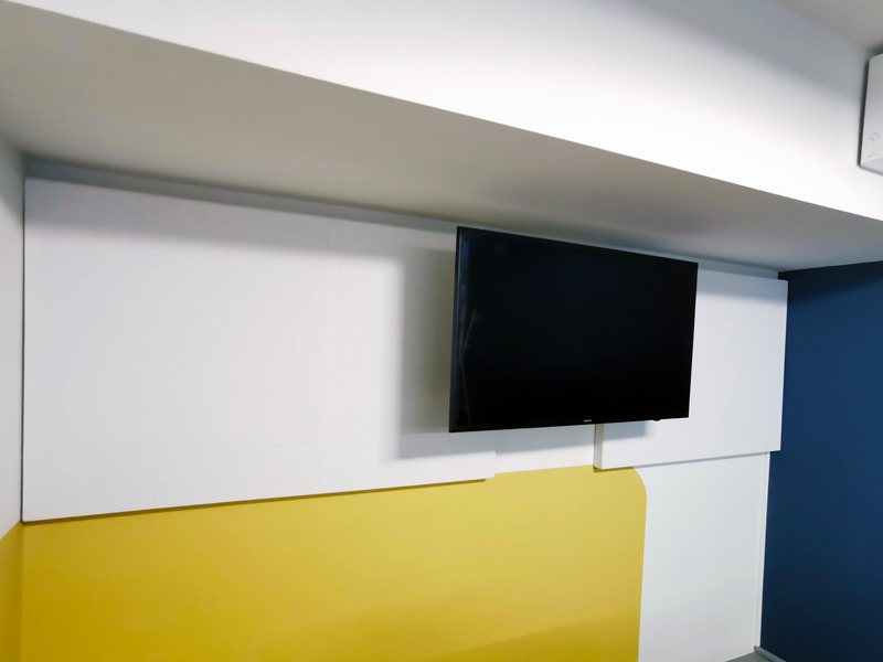 acoustic panels behind tv